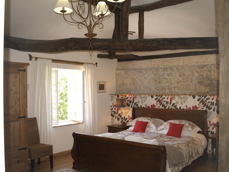 Master bedroom with Super-king size bed, vaulted ceiling and en-suite wet room. Loads of storage too