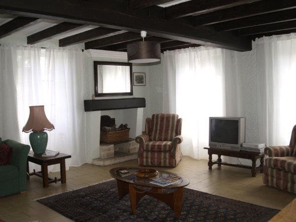 The comfortable sitting room has plenty of seats and a double aspect for lots of light