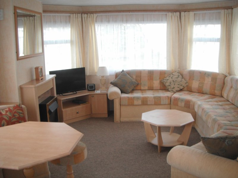 Lounge area with plenty of seating. Freeview TV with built in DVD player and fitted Electric fire.