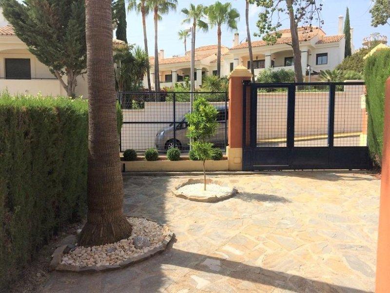 Front Garden para Townhouse com a Orange e palmeira