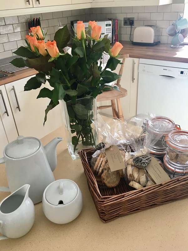 The kitchen, roses and welcome hamper.