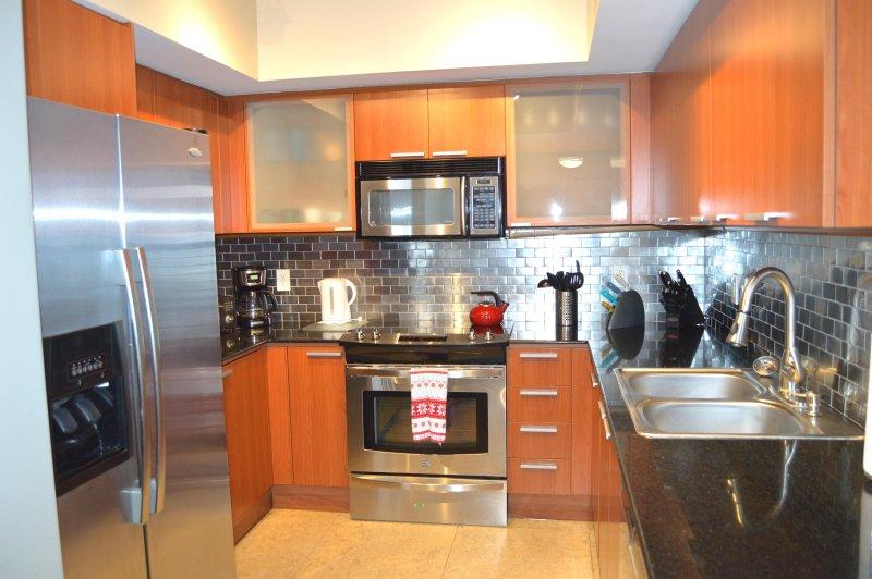 Modernt kök - fullt utrustat för alla dina matlagning behov.