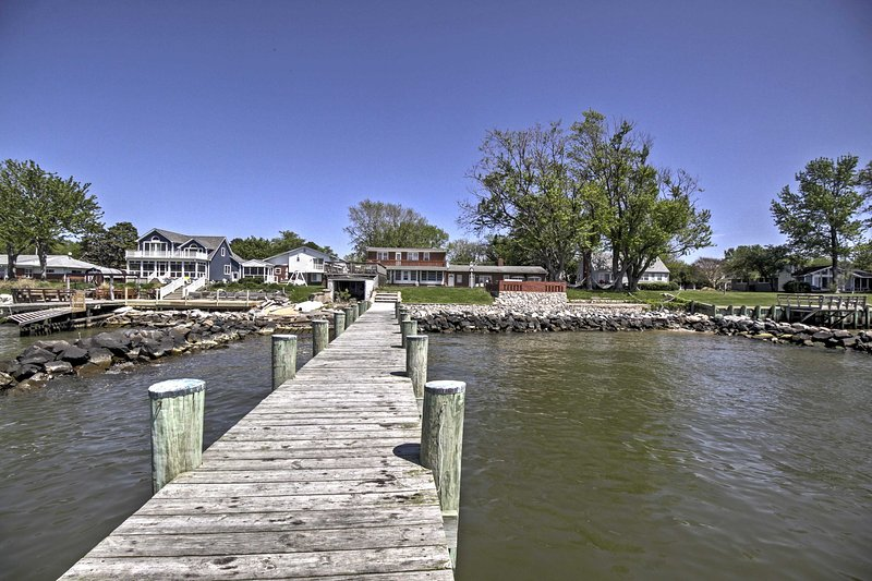 With a 120-foot pier, a large yard and spacious interior, this Stevensville vacation rental home is the perfect spot for your family retreat!