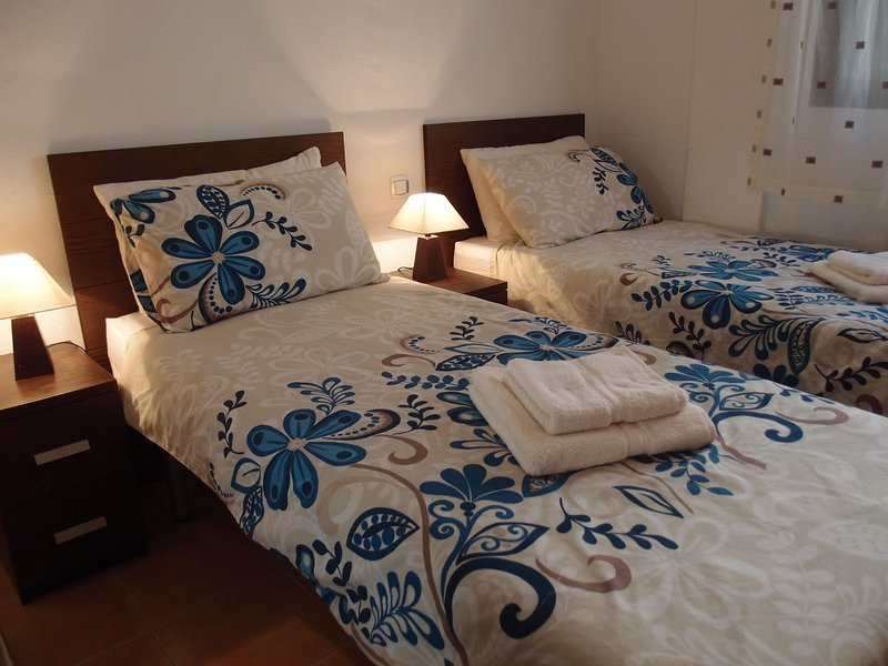 Second bedroom with two comfortable single beds