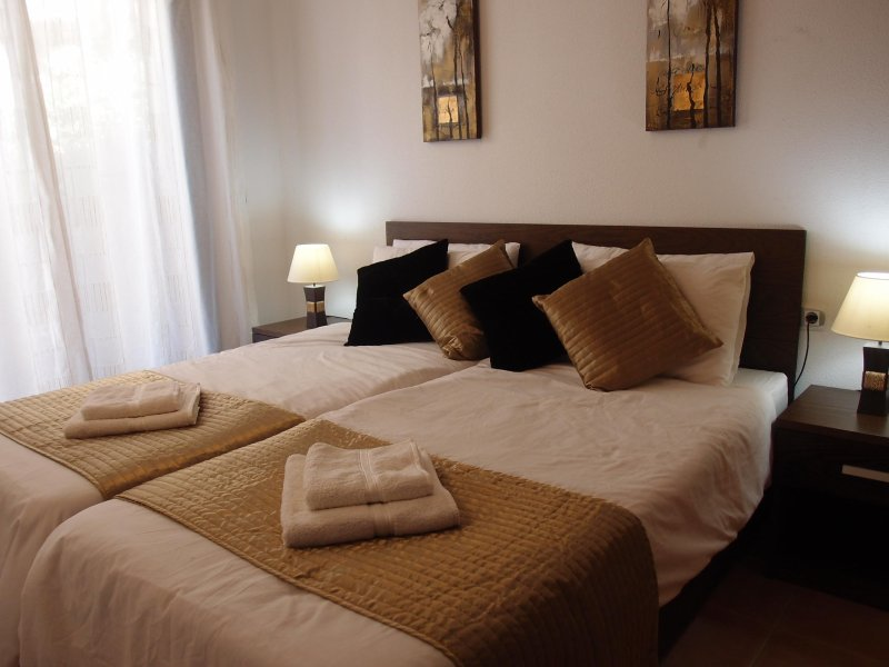 Master bedroom with two comfortable single beds