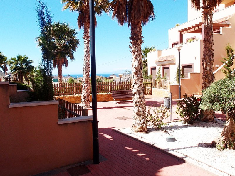Looking towards pool and Aguilas bay from apartment garden. Sea views.