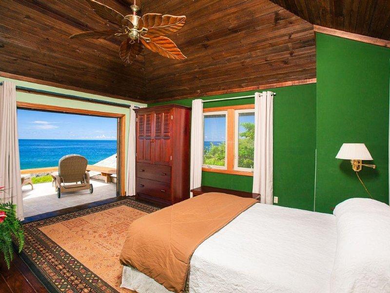 Master bedroom with en-suite bathroom, private deck and sea views