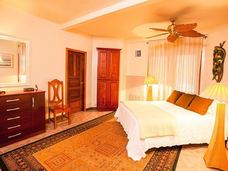 South guest bedroom with queen bed and en-suite bathroom