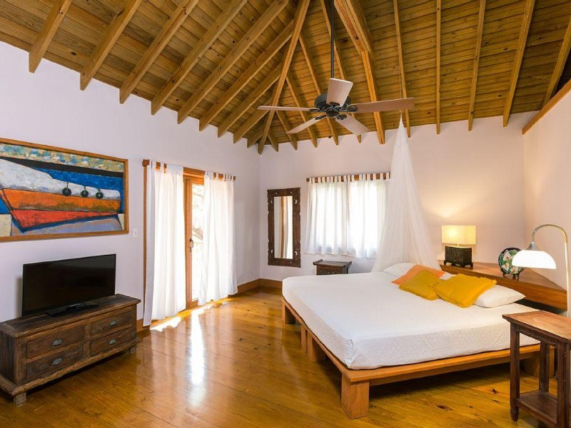 Master Suite with King size bed and private terrace overlooking the courtyard.