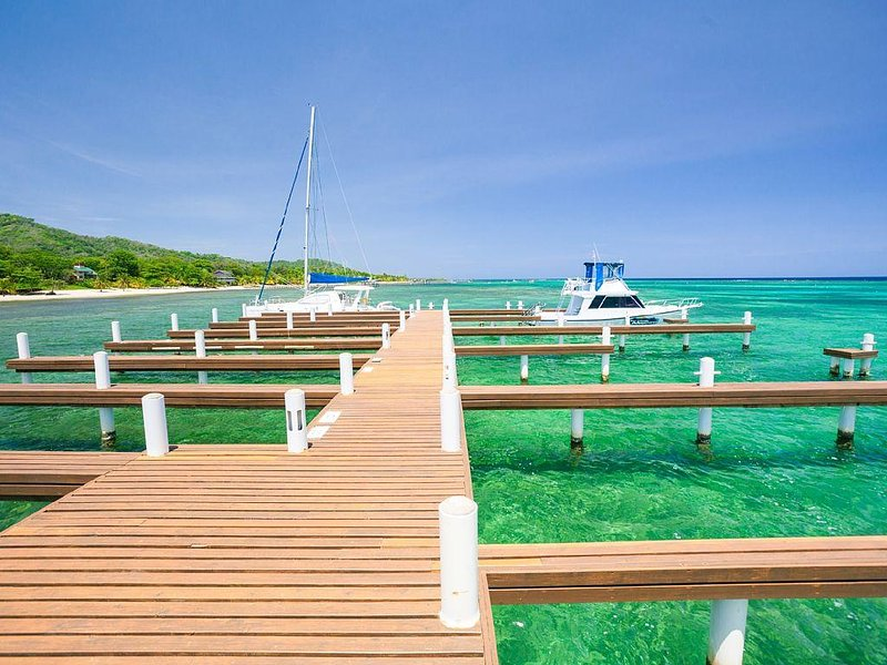 Private dock with boat slips.  Turquoise water all around....