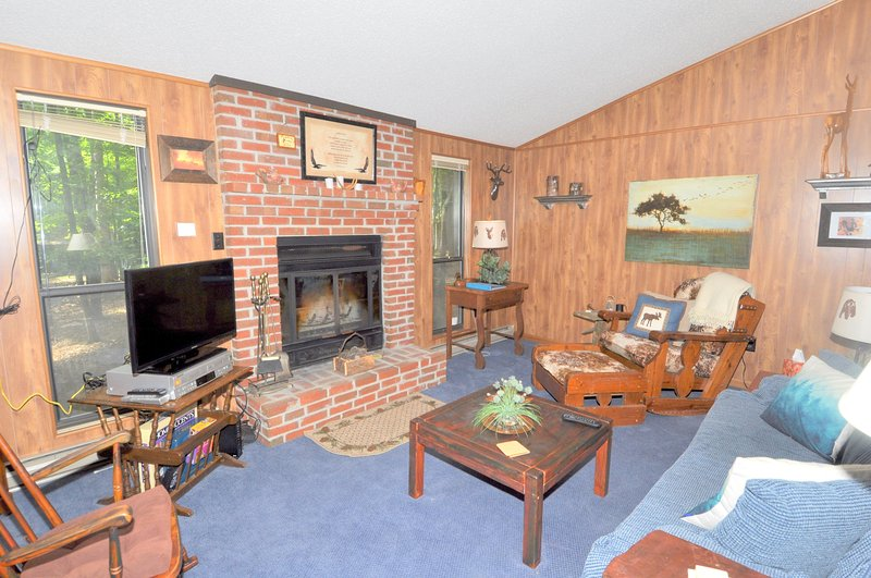 The living room features a fireplace and flat screen TV with cable programming.