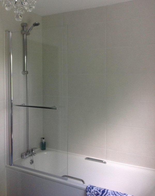 Shower over bath in main bathroom.