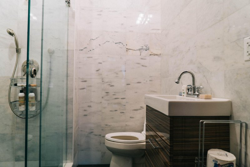 Shower bath in beautiful white marble tiles.