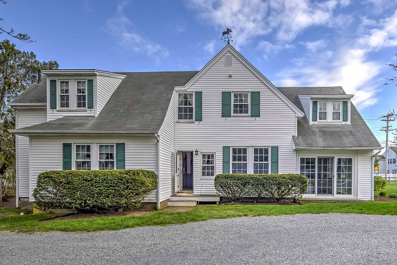 Enjoy this quaint seacoast town of Hyannis Port from this 8-bedroom, 4.5-bathroom vacation rental house in Massachusetts.