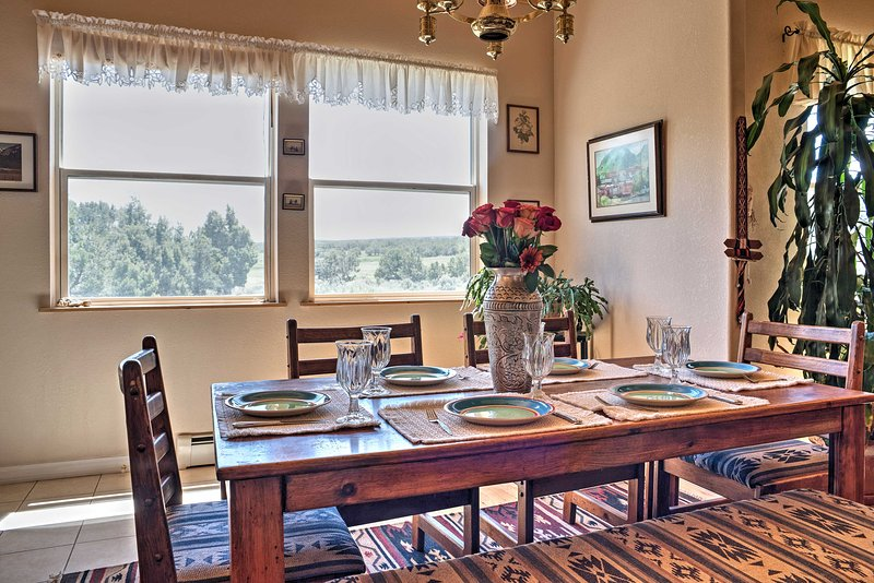 Gather around this charming dining table and enjoy a meal with your loved ones.