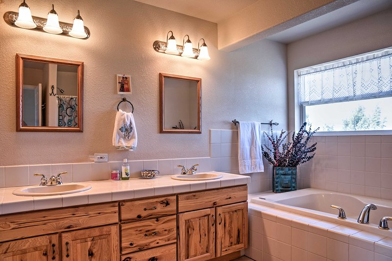 Freshen up in this pristine full bathroom which includes a soaking tub and walk-in shower.
