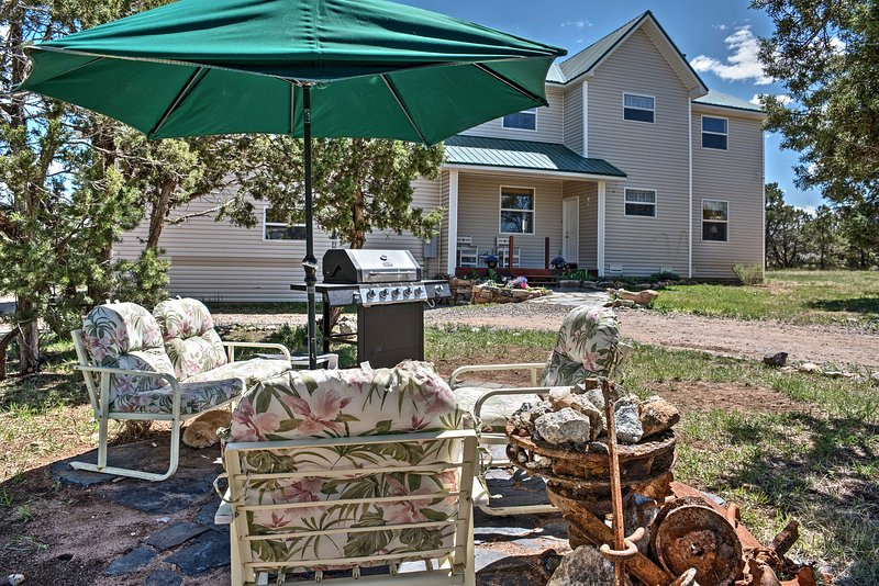 Throw some steaks on the grill and enjoy your feast in this lovely shaded patio area.