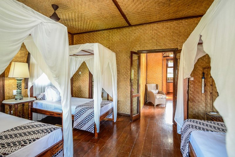 3 Four poster beds with private balcony looking to the ocean.