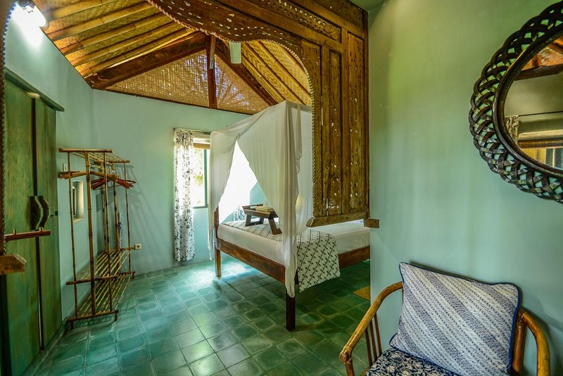 This delightful romantic bedroom has a sitting room overlooking the pool and garden.