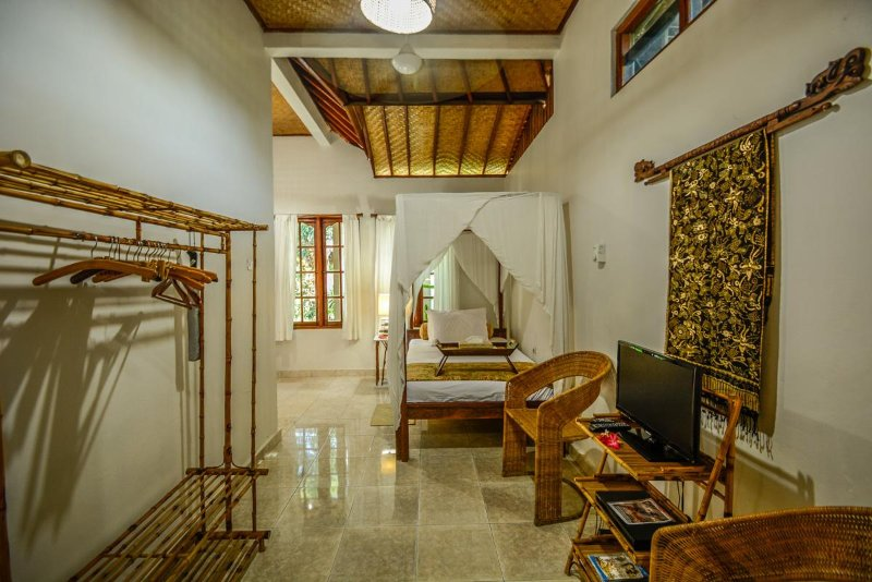 spacious and breezy with large windows looking onto our temple.DVD player,TV with current movies