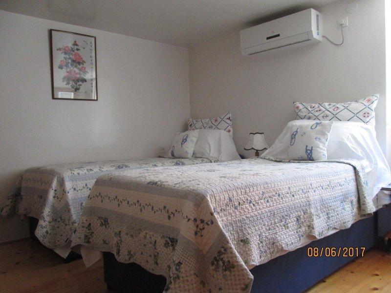 An airy twin room