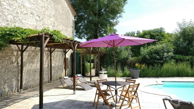 Swimming pool patio area. Plenty of loungers, chairs, tables and a decked area to suit your needs.