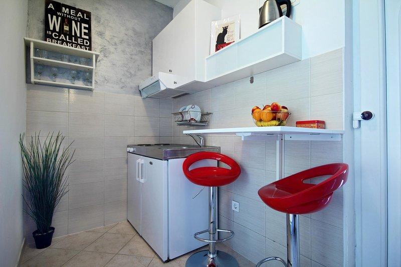 Offene Küche mit direktem Zugang zur Terrasse