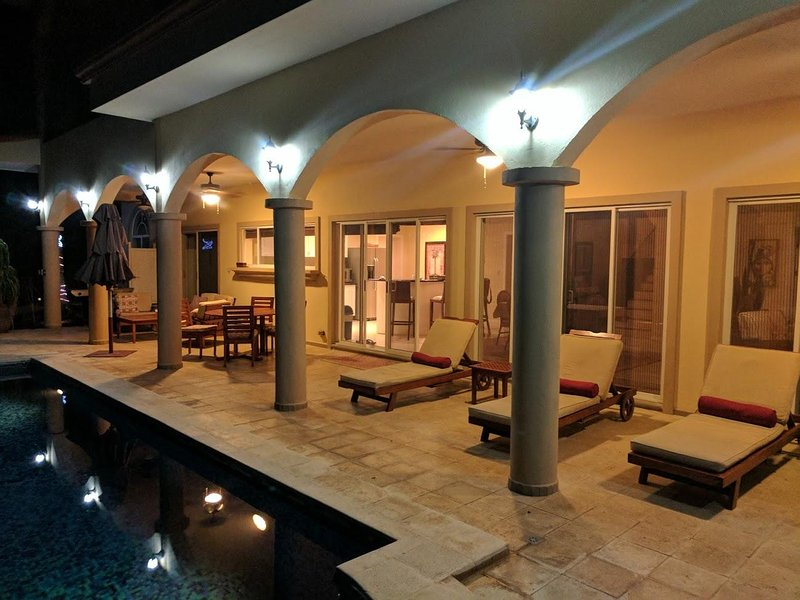 pool terrace lighted with ceiling fans for comfort