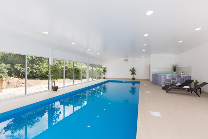 Indoor heated swimming pool, hot tub and relaxation loungers.