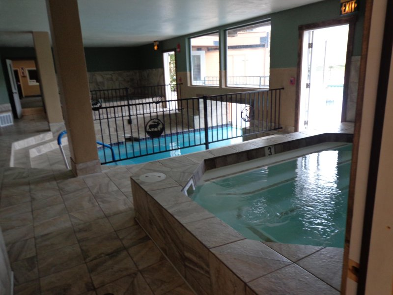 On right, 1 of the 4 hot tubs (2 inside, 2 out). And pool entrance on left. All open all year!