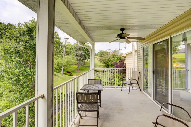Step outside to your covered patio balcony and enjoy the forested views.