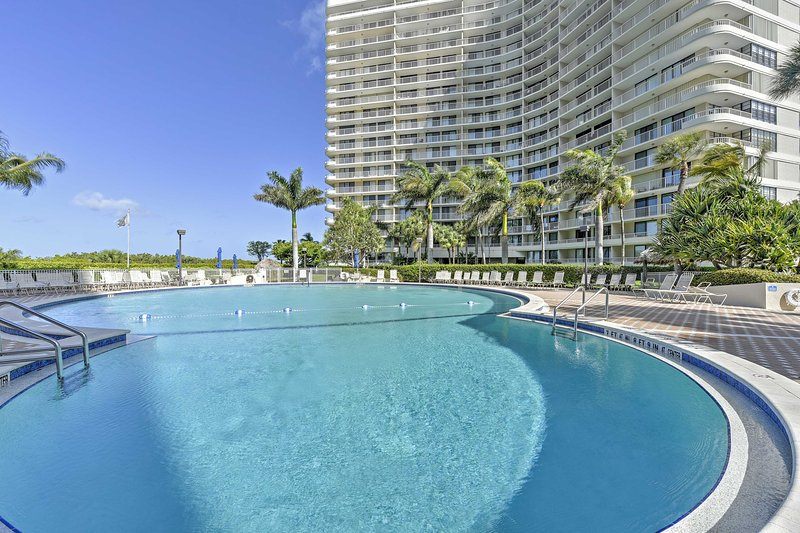 Lounge poolside at this beachfront Marco Island vacation rental!