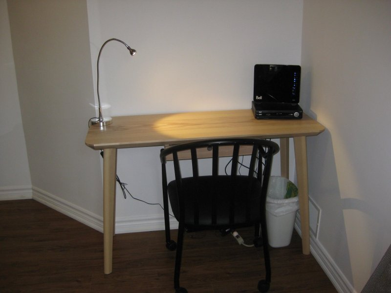 Desk with desk lamp, with choice of 2 desk chairs.