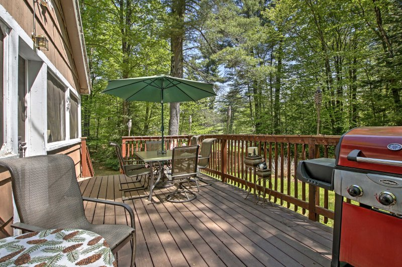 This Goshen vacation rental home boasts a large deck, perfect for afternoon barbecues.