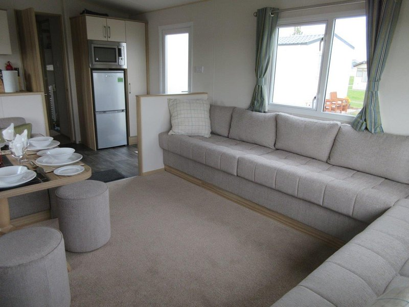 Spacious open plan lounge with sofa bed