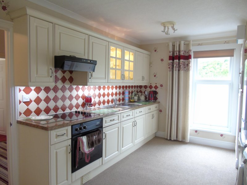 Fully fitted kitchen including washing machine, tumble dryer and dishwasher.