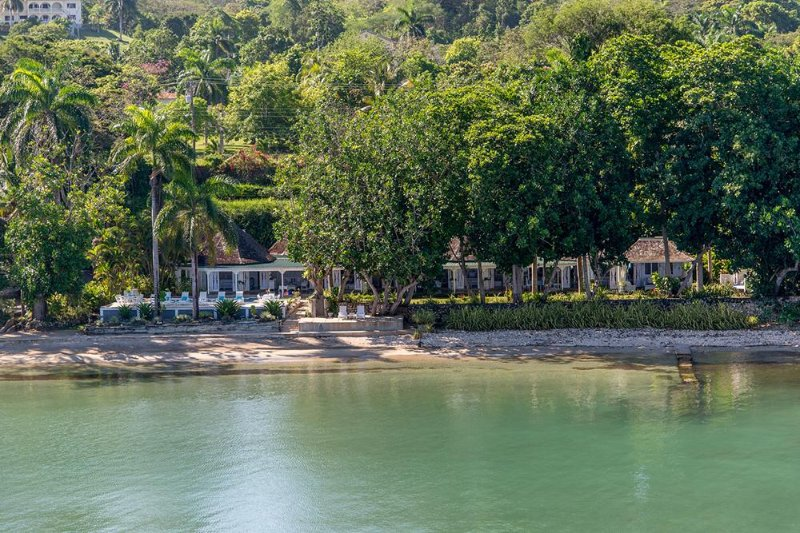SERENITY ON THE BEACH is a four-bedroom  fully-staffed villa ...