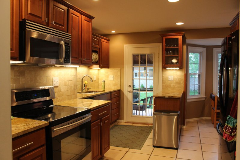 Gourmet kitchen with convection oven and induction cooktop. Granite countertops and stainless steel