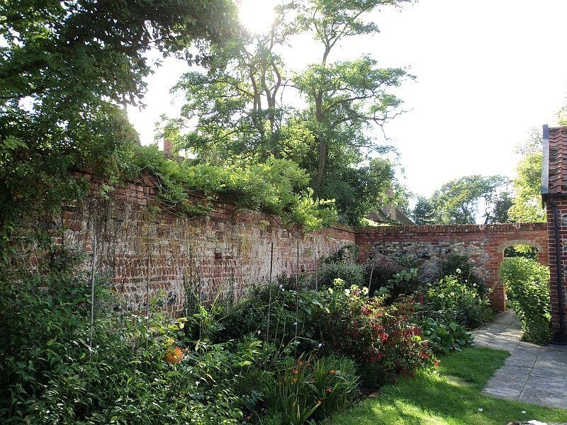 Walled garden surrounding the cottage in late summer.