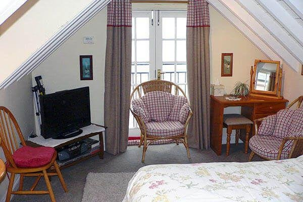 The Old Clink Annexe comfortable bedroom and balcony