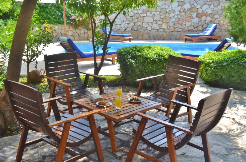 Relax with a drink in the beautiful gardens