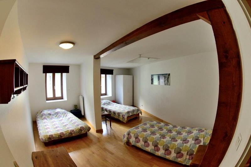 The quadruple room has a double bed and two single beds, ideal friends.