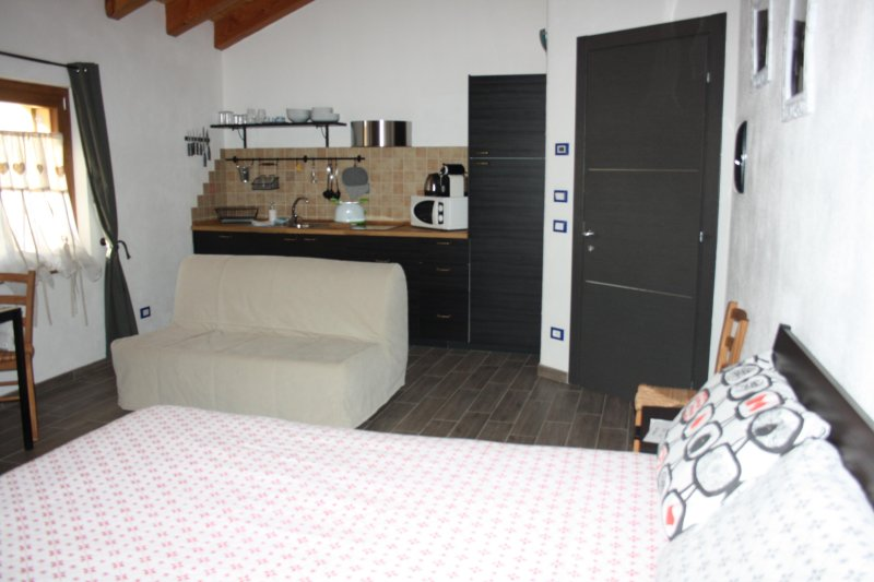 SAPPHIRE studio with a sofa and kitchenette