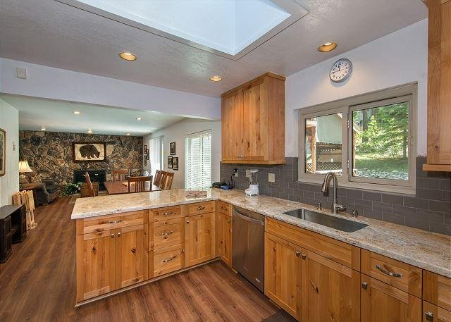 The large kitchen opens to the dining and perfect for gathering