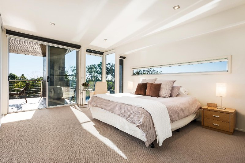 The spacious Master King bedroom has  floor to ceiling wardrobes and its own TV and DVD