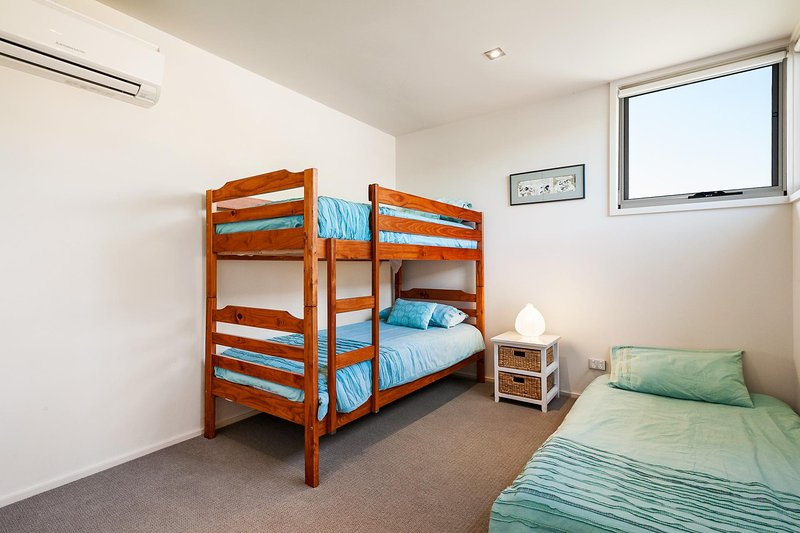 Bunk bedroom with additional trundle