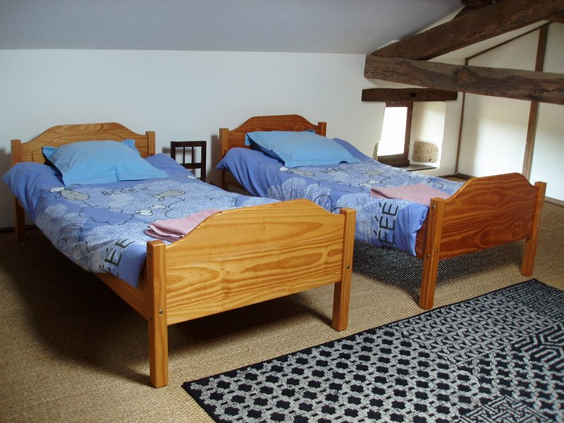 Two single beds in the loft