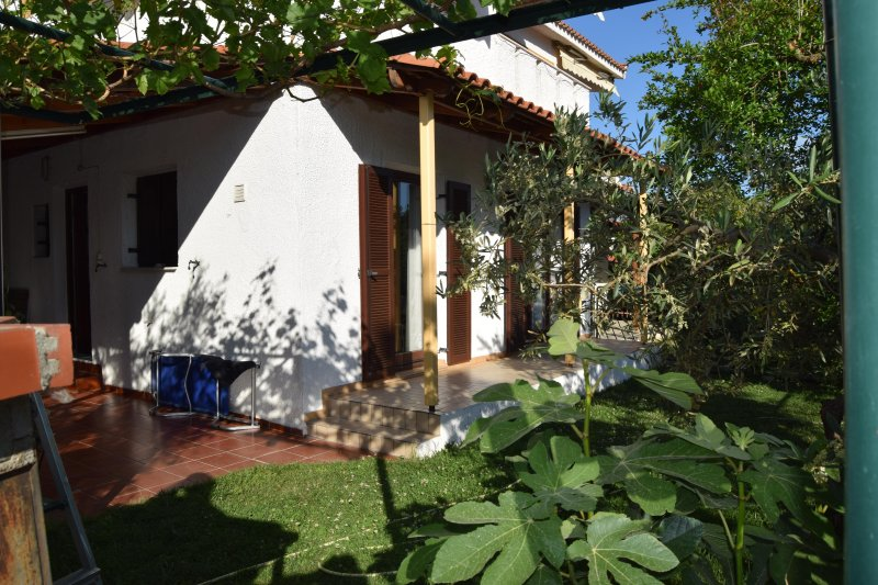 Garden Family Home, close to the Beach. Spacious veranda and comfortable inside for your relaxation