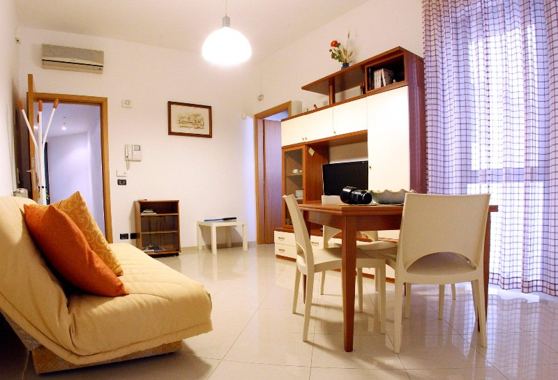 The living room with dining area, air conditioning, satellite TV and sofa-bed two places