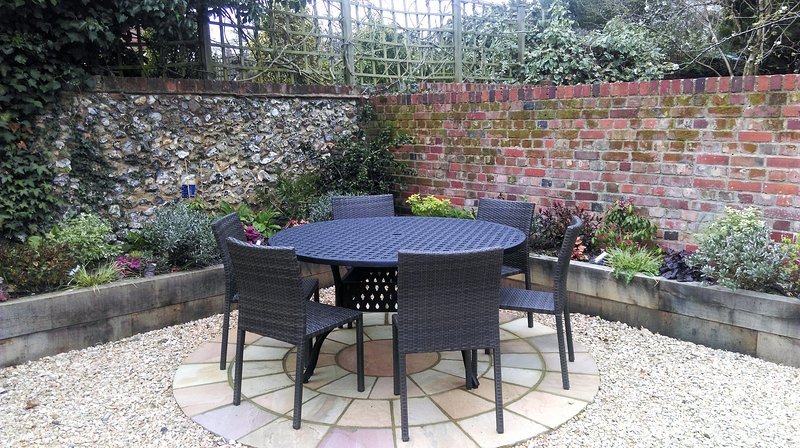 The secluded patio area is great for summer BBQs!